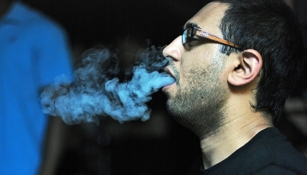 man smoking a hookah