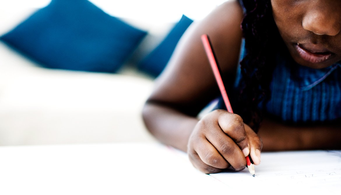 girl writes with pencil