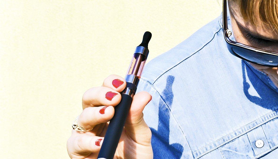 young woman holding an e-cigarette