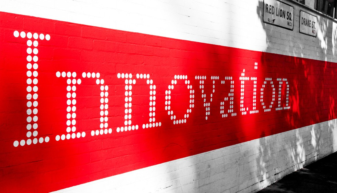red innovation sign on wall