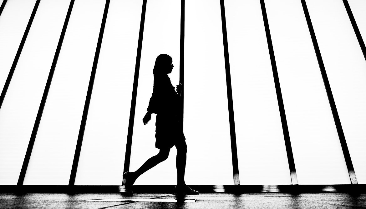 silhouette of a woman walking