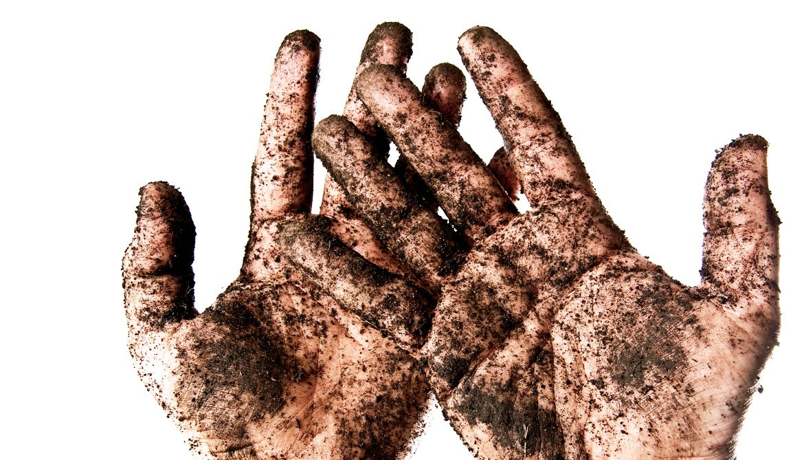 soil on hands