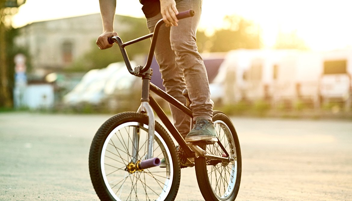 teen guy on bmx bike