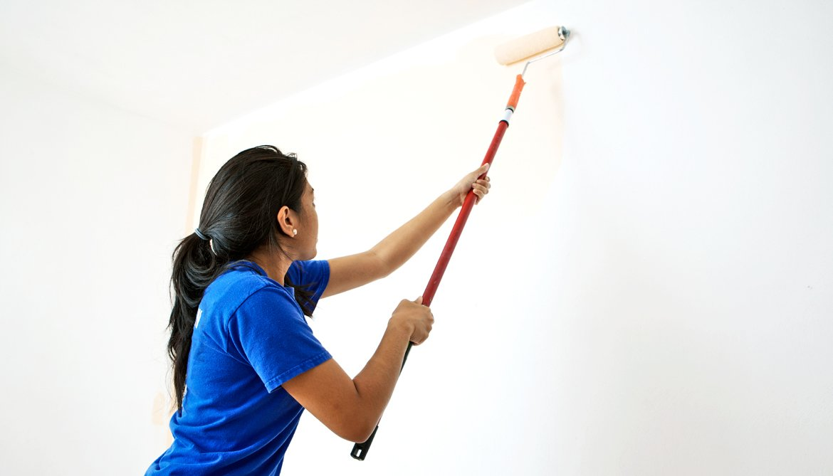 teen painting wall - summer jobs