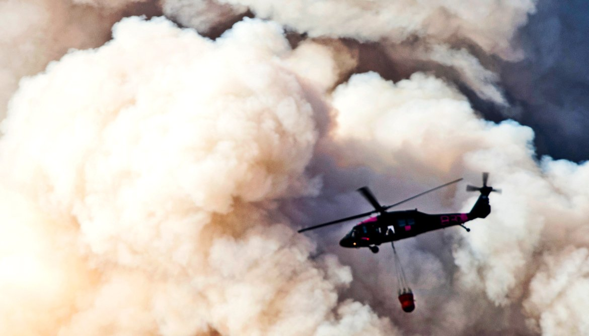 helicopter in smoke from wildfire