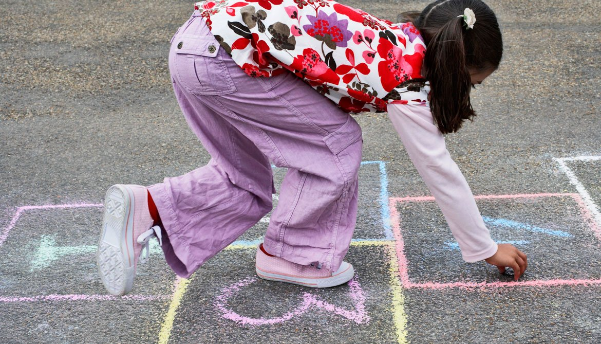 girl plays hopscotch
