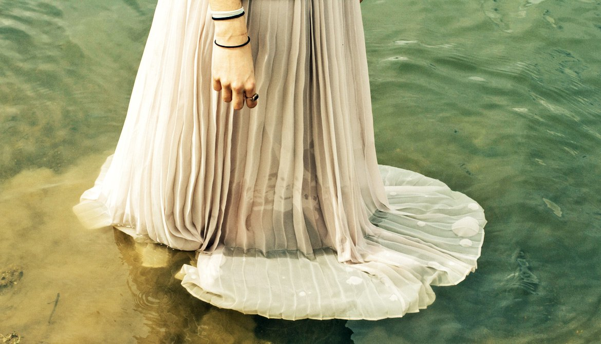 wedding dress in river