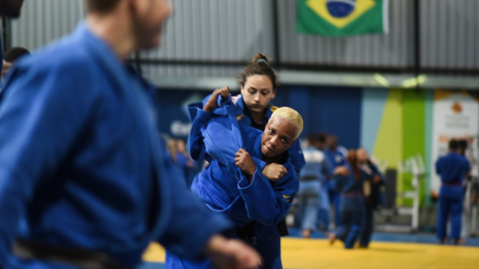 Yolande, back in training, practises with a young Brazilian Judo enthusiast.