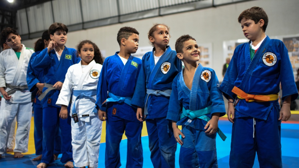 Young Brazilians at the Judo training centre look in admiration at Olympians Yolande and Popole.
