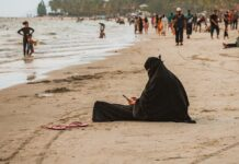 Women burka beach