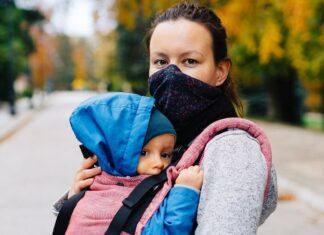 Woman with facemask and her son